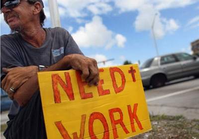 man with sign, 'need work'